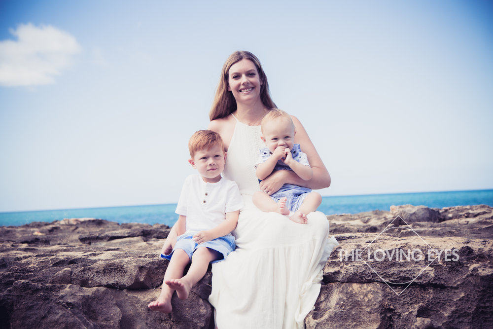 Family portrait at the beach in Ko Olina on vacation in Hawaii