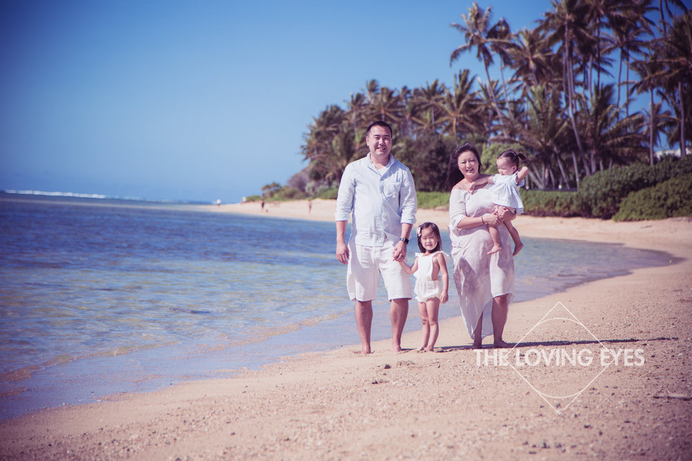 Family portrait at the beach on vacation in Hawaii
