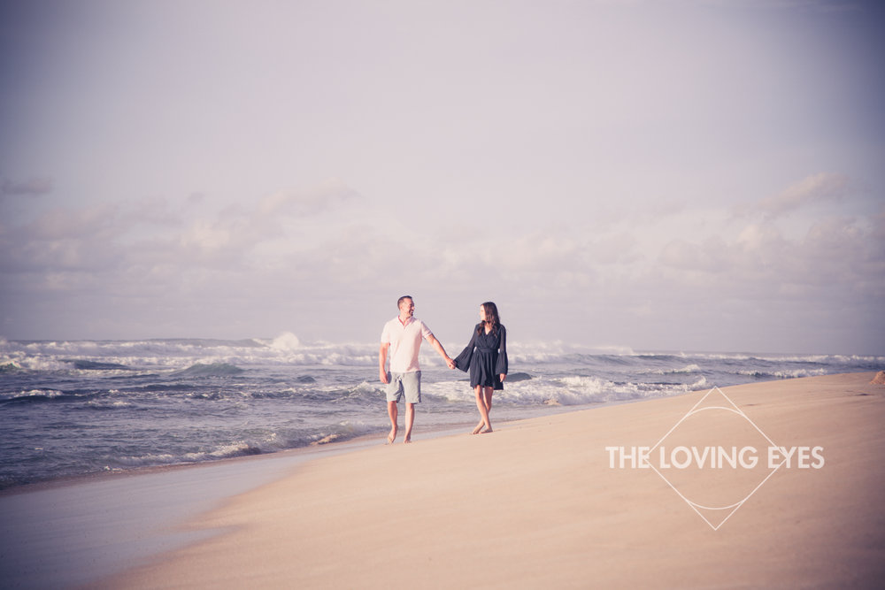 Engagement photo walking on the beach in Hawaii