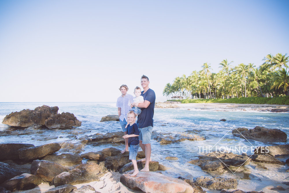 Family portrait on the beach in Ko Olina during vacation in Hawaii
