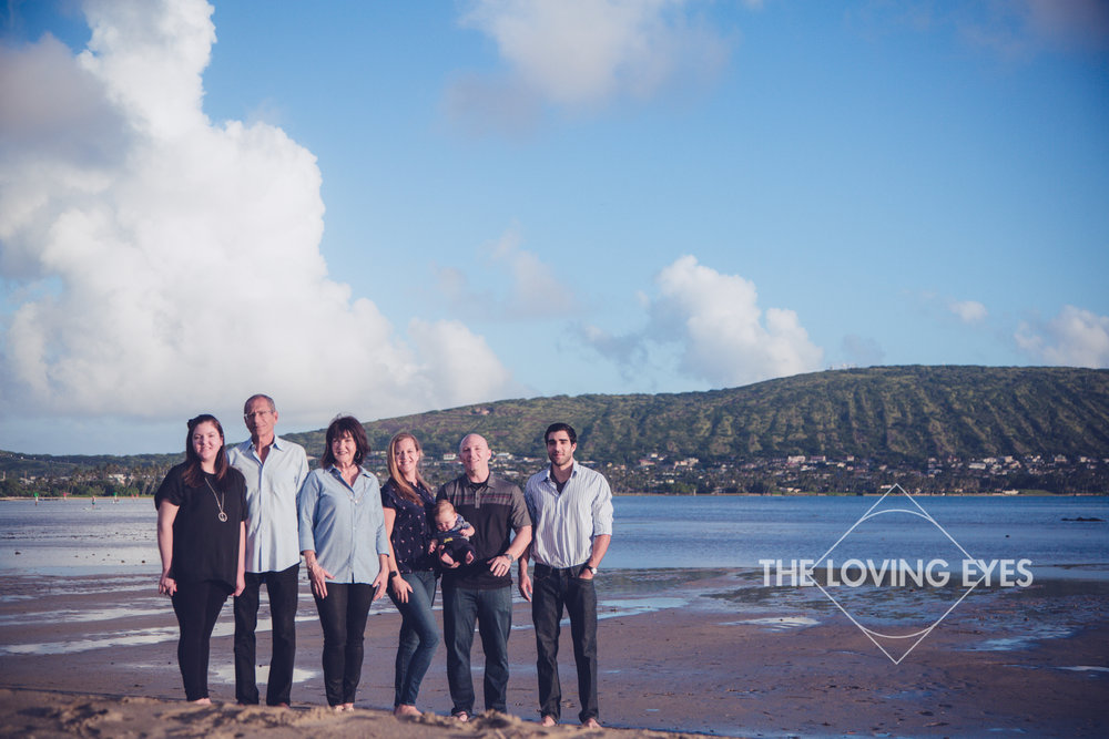 Family portrait during vacation on the beach in Kuliouou Hawaii