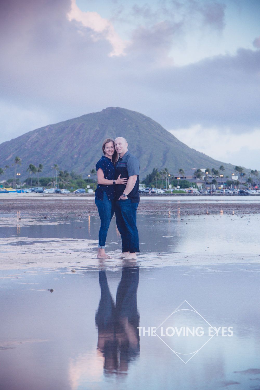 Couple portrait during vacation on the beach in Kuliouou Hawaii