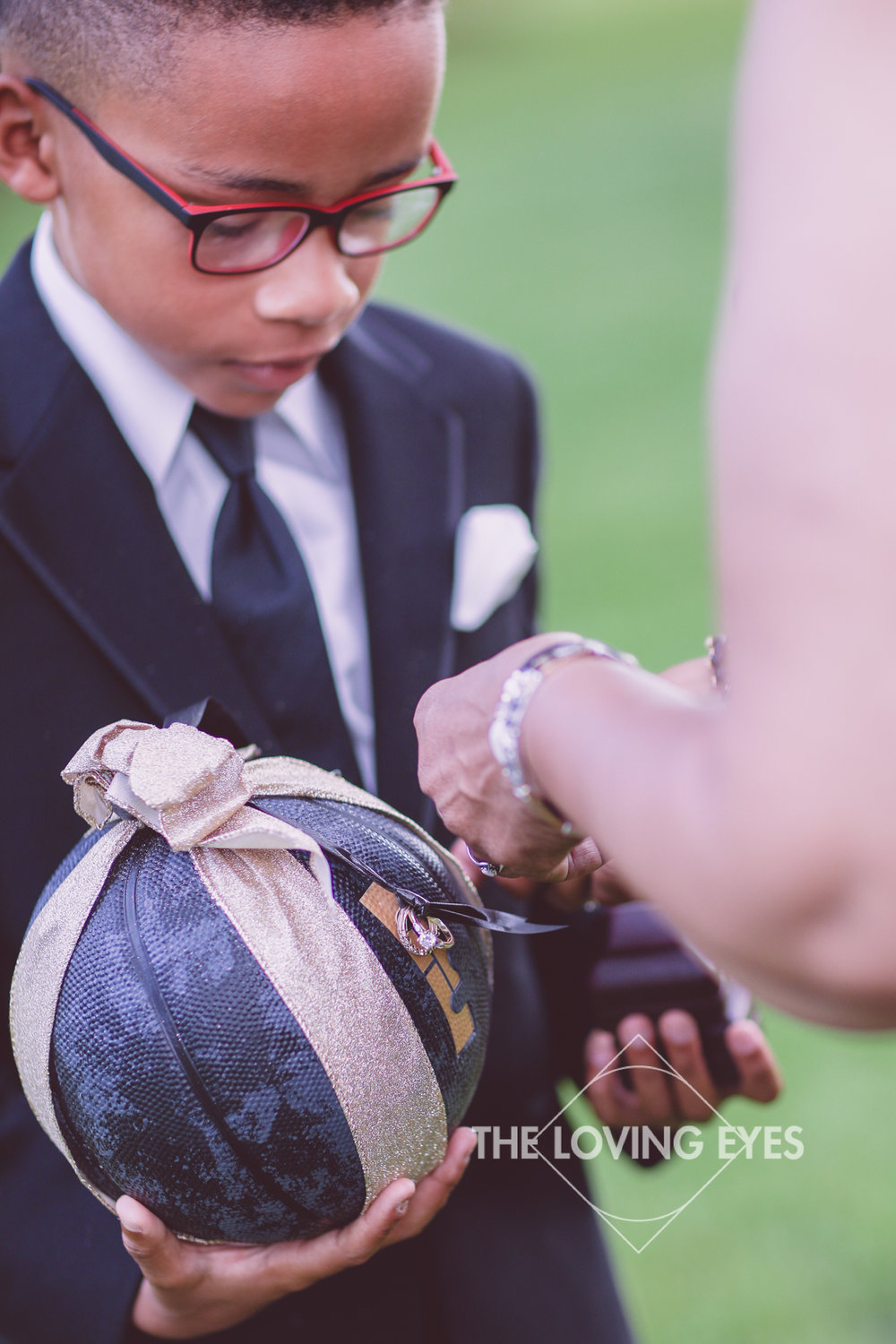 Ring bearer getting ready before wedding ceremony at the Hanalani Chapel in Hawaii