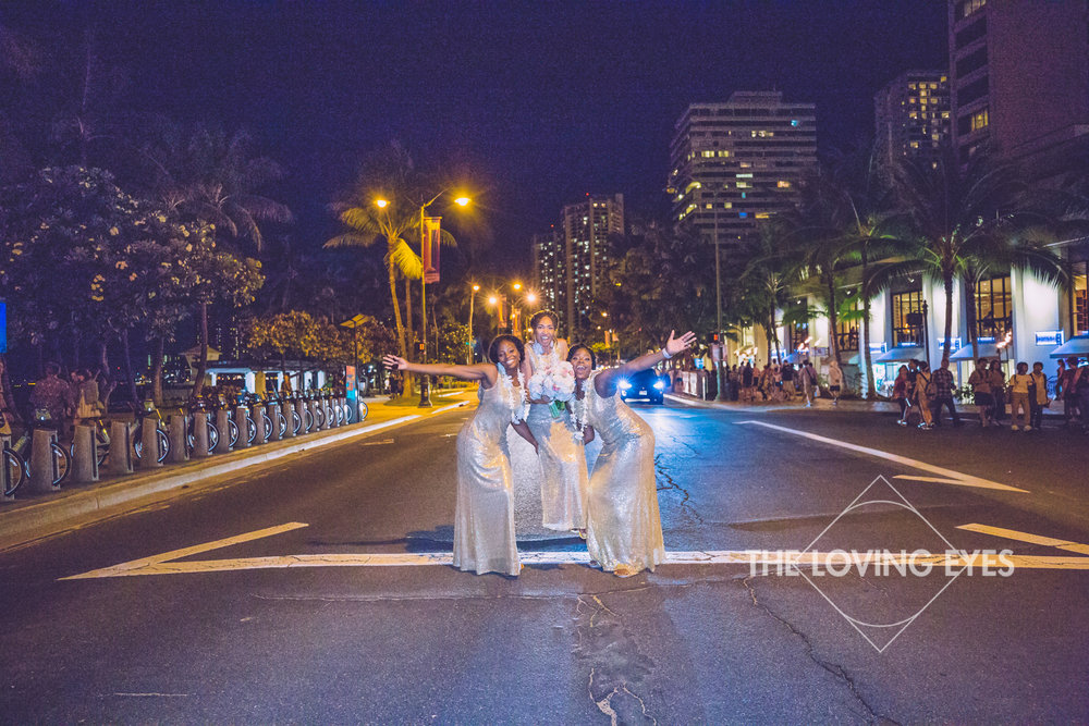 Bride and her bridal party on the street at night in Waikiki