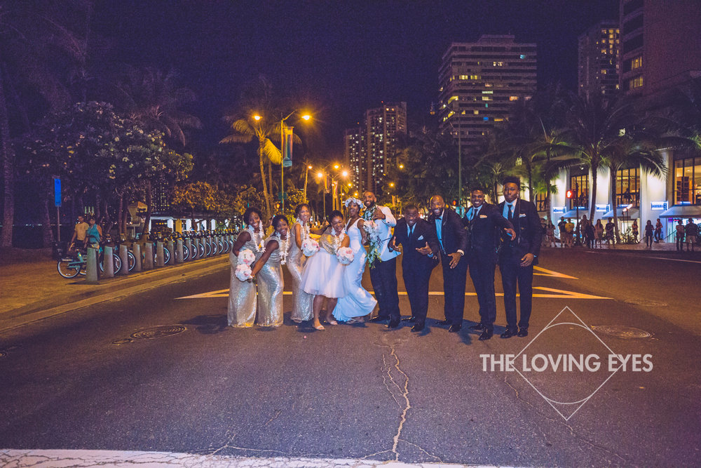 Bridal party on the street at night in Waikiki
