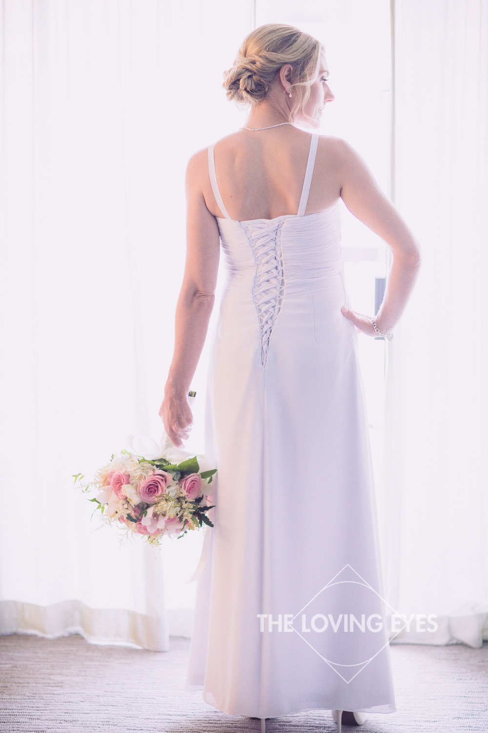 Bridal portrait with bouquet on wedding day