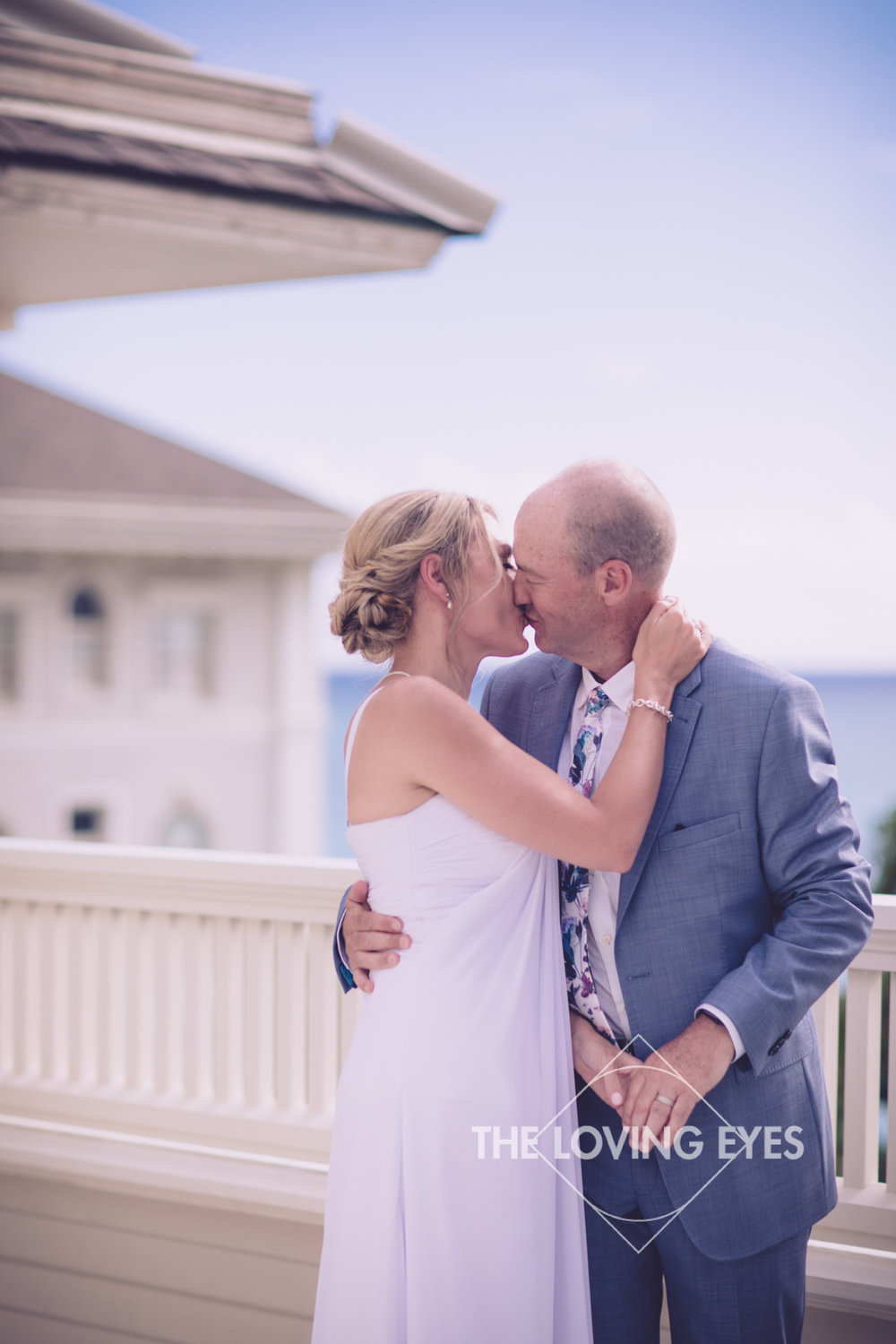 Roof top elopement wedding ceremony at the Moana Surfrider in Waikiki