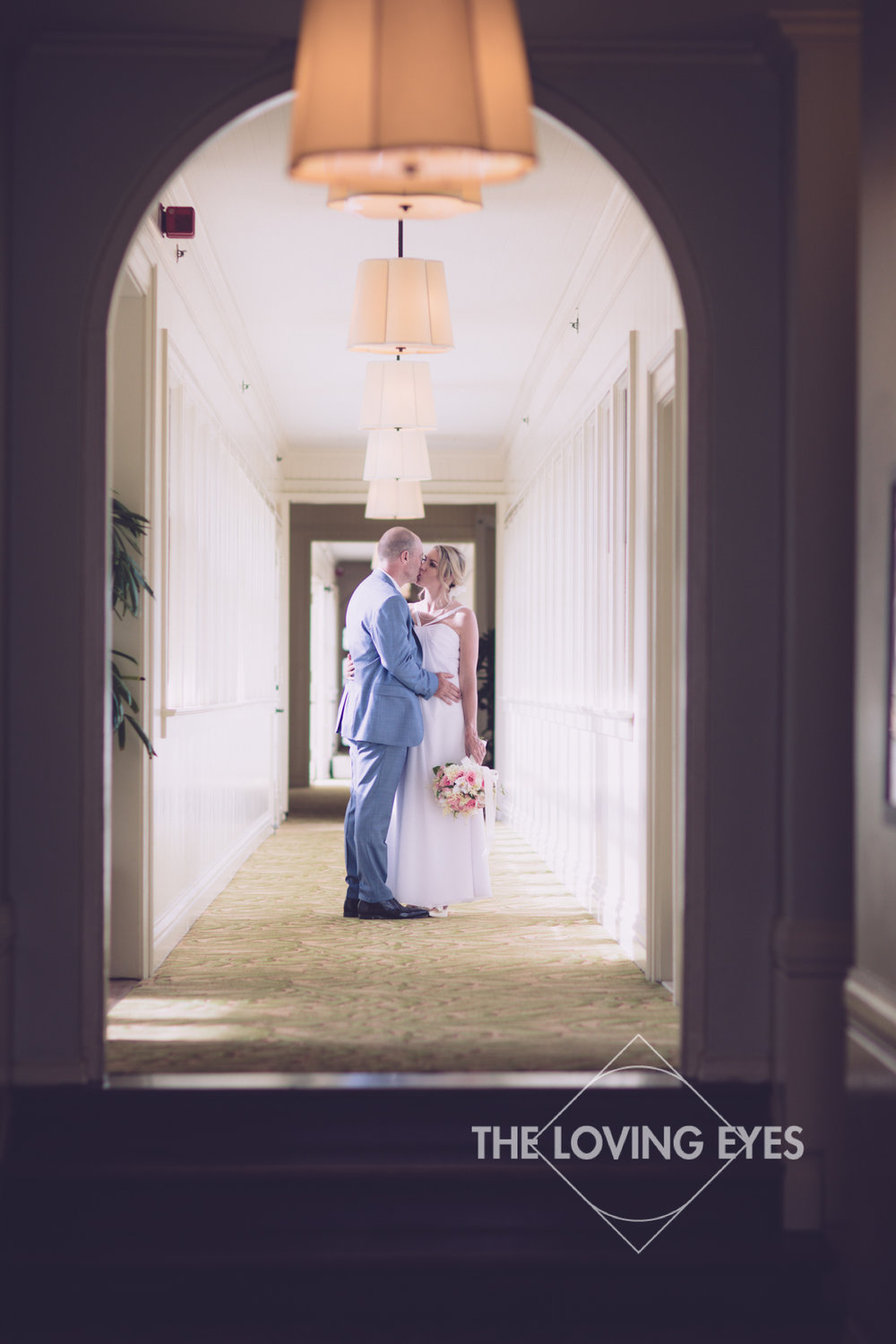 Bride and groom on their wedding day at the Moana Surfrider in Waikiki