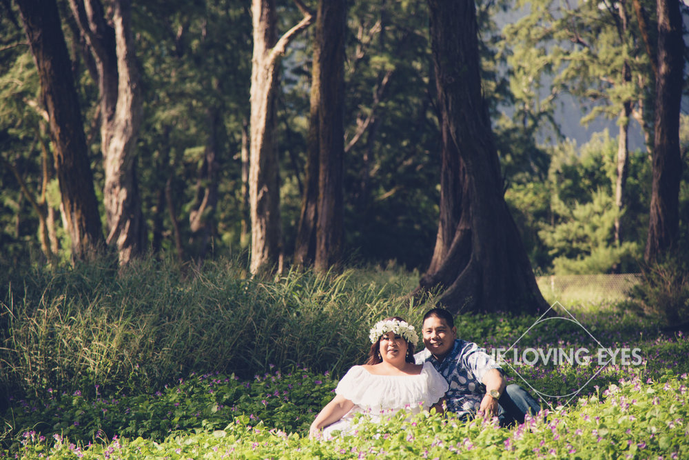 Engagement photo in a field of flowers at Waimanalo in Hawaii