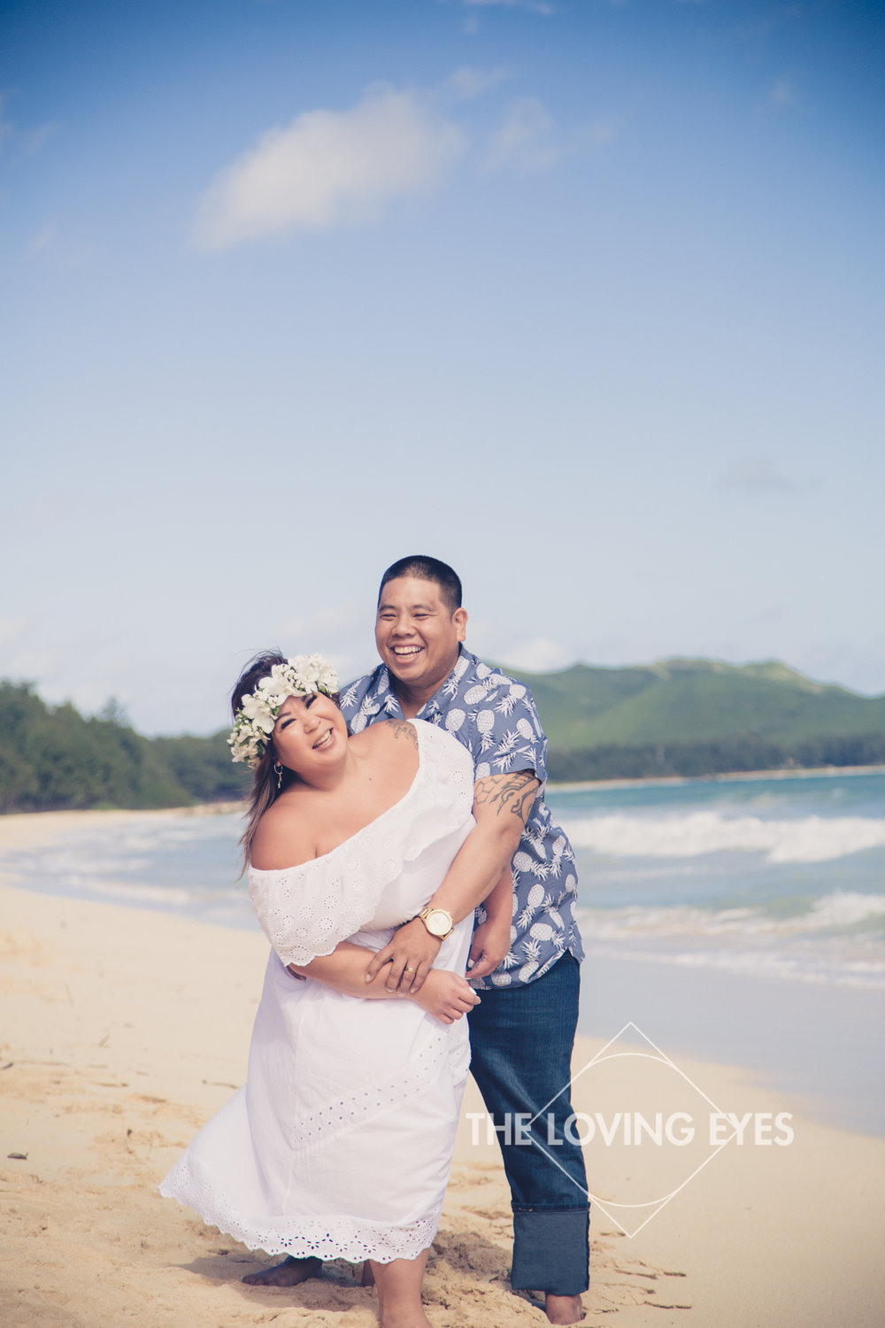 Fun engagement photos on the beach in Waimanalo in Hawaii