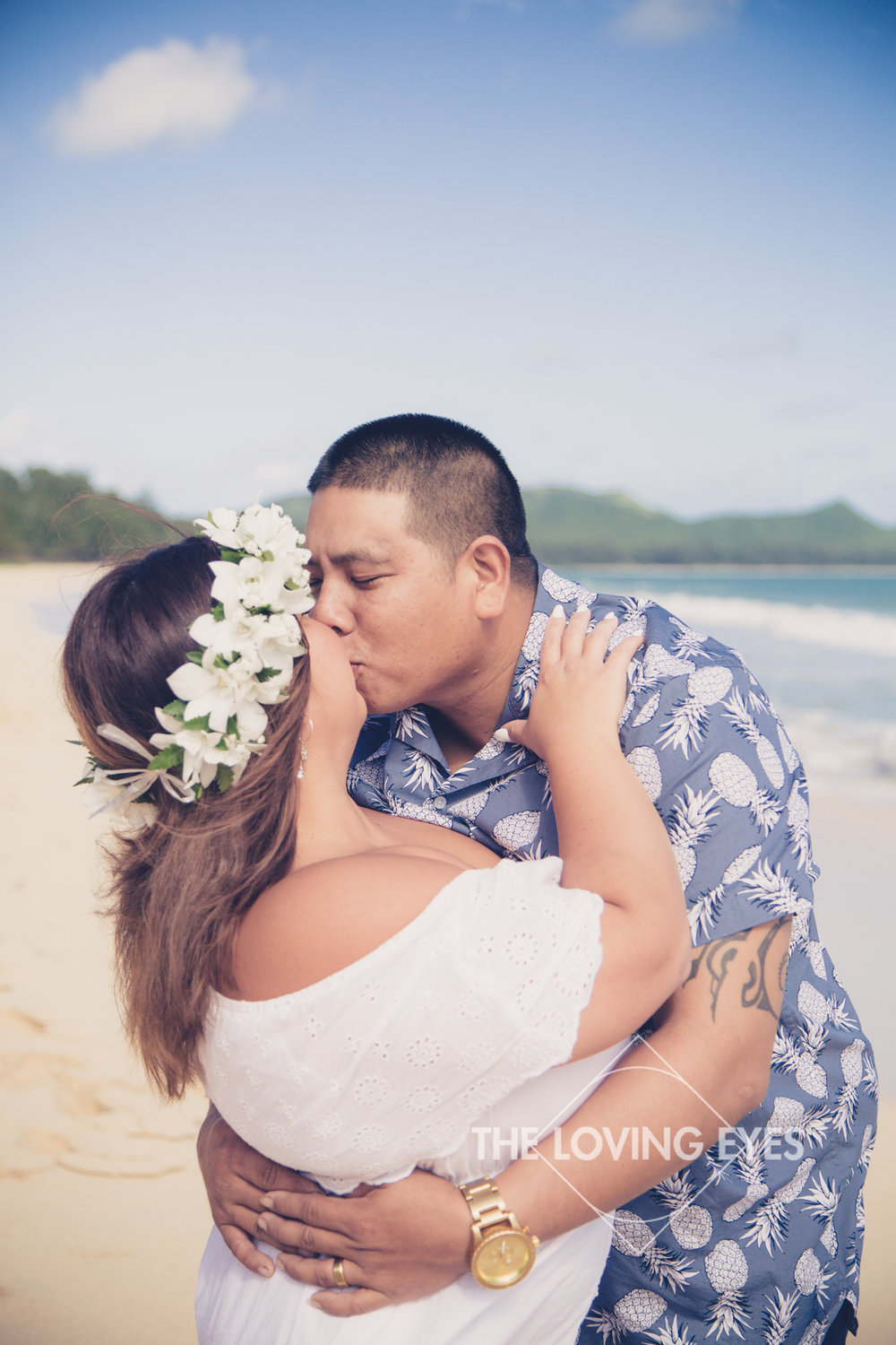 Engagement photo kiss on the beach in Waimanalo in Hawaii