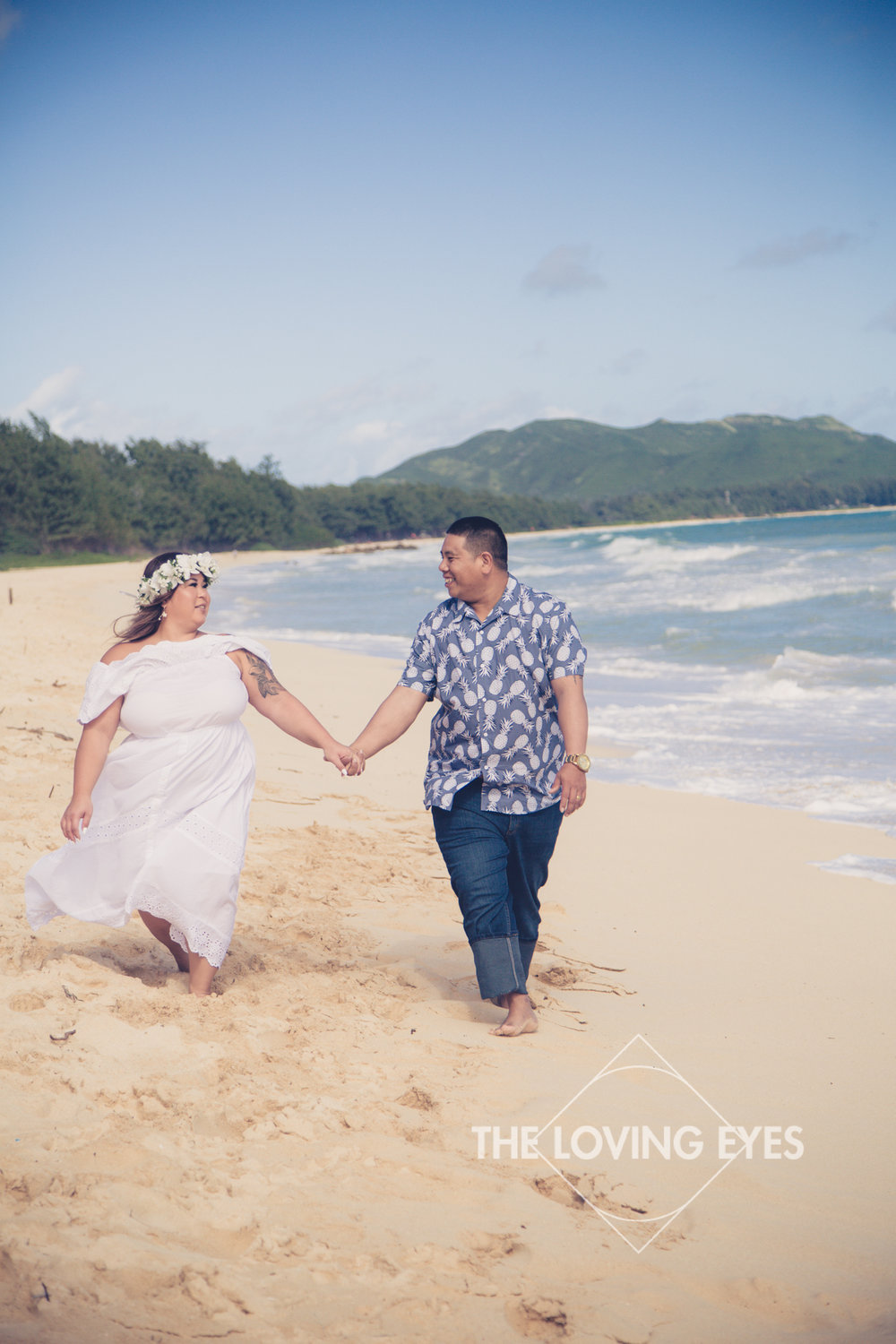 Fun engagement photo walking on the beach in Waimanalo in Hawaii