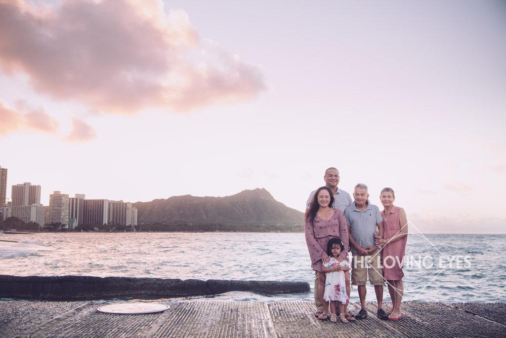 Family vacation photo at Waikiki Beach during sunrise in Hawaii