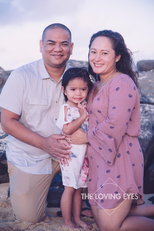 Family portrait on the beach in Waikiki during sunrise in Hawaii