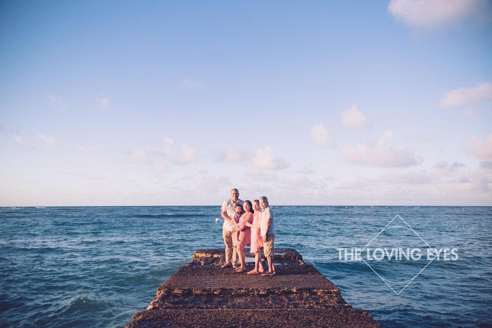 Family portrait at the beach in Waikiki in Hawaii