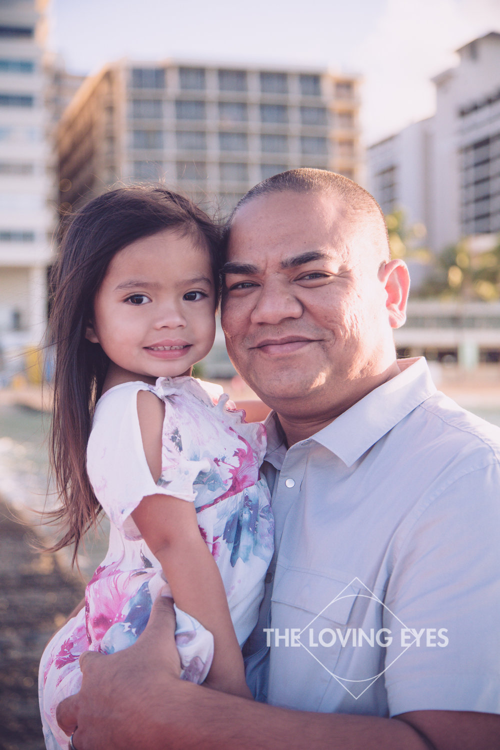 Father and daughter portrait on the beach in Waikiki in Hawaii