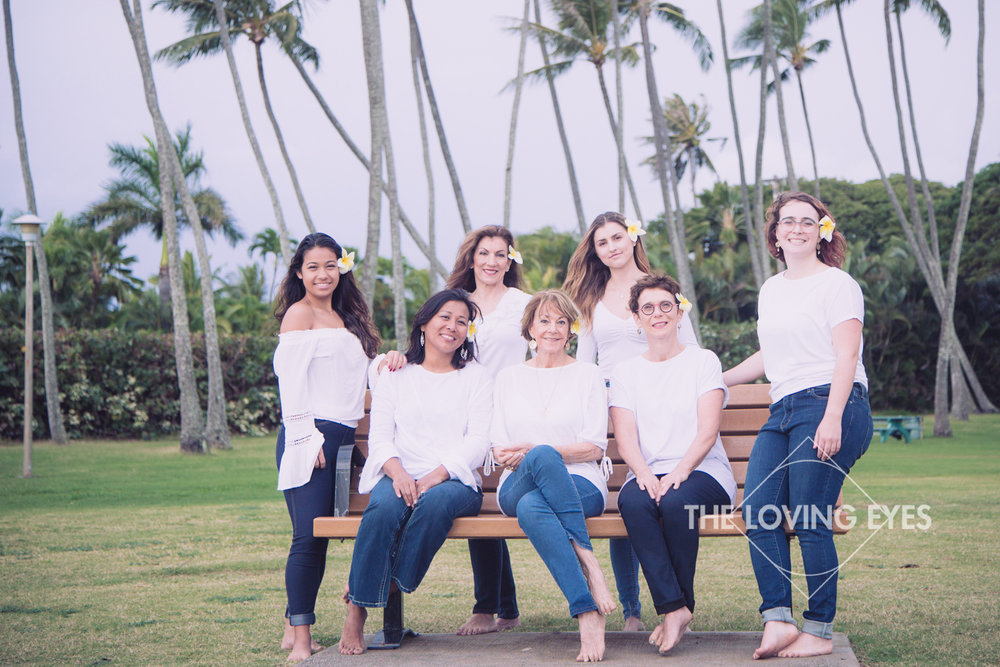 Family portrait at Waialae Beach Park in Hawaii
