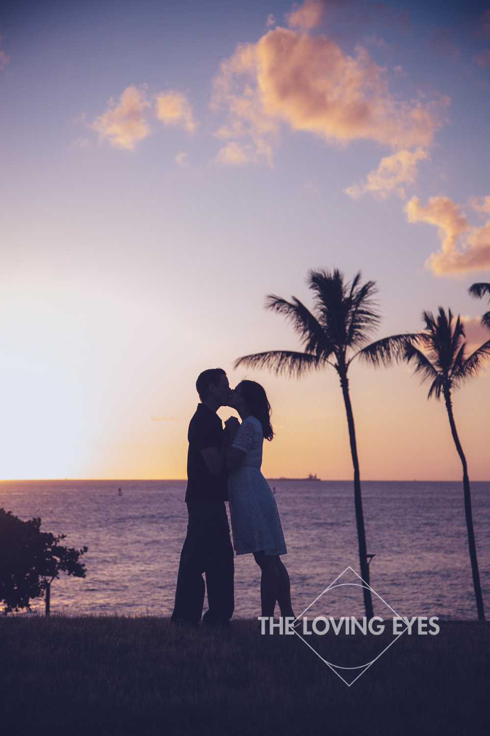 Engagement photo during sunset at Kakaako Waterfront Park in Hawaii