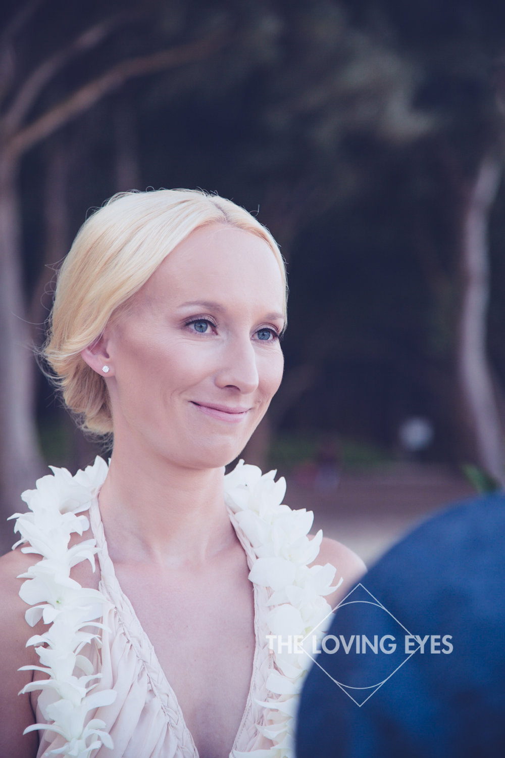White orchid lei for bride for Hawaiian beach elopement