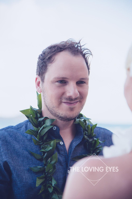 Lei for groom on Hawaiian beach elopement