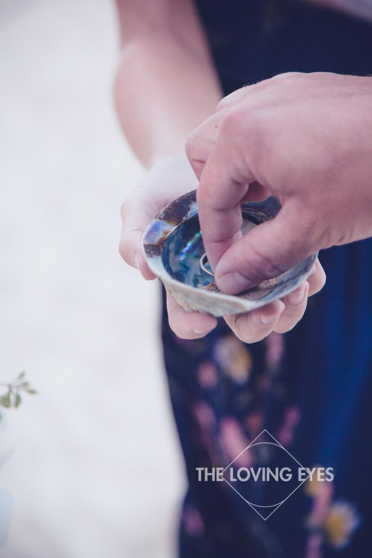 Wedding rings on Hawaiian beach elopement