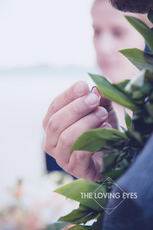 Wedding ring on Hawaiian beach elopement
