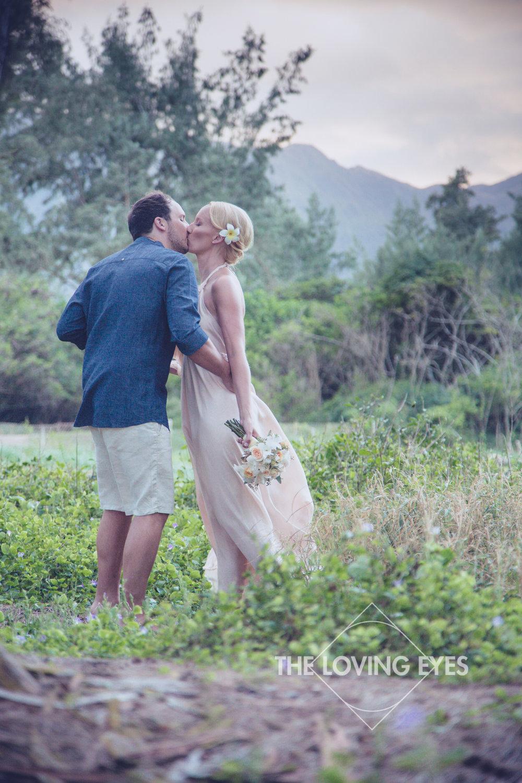 Bride and groom kiss in Hawaii