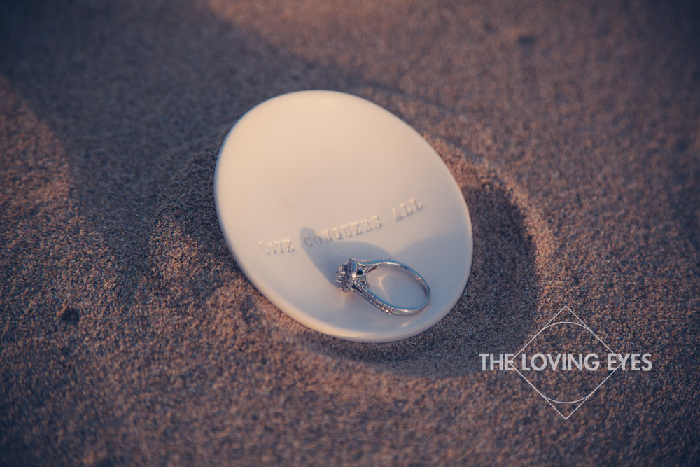 Engagement ring on the beach at Ala Moana Beach Park in Hawaii
