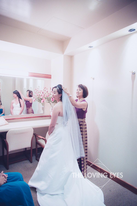 Bride getting ready with mom in Bishop Memorial Chapel bridal suite