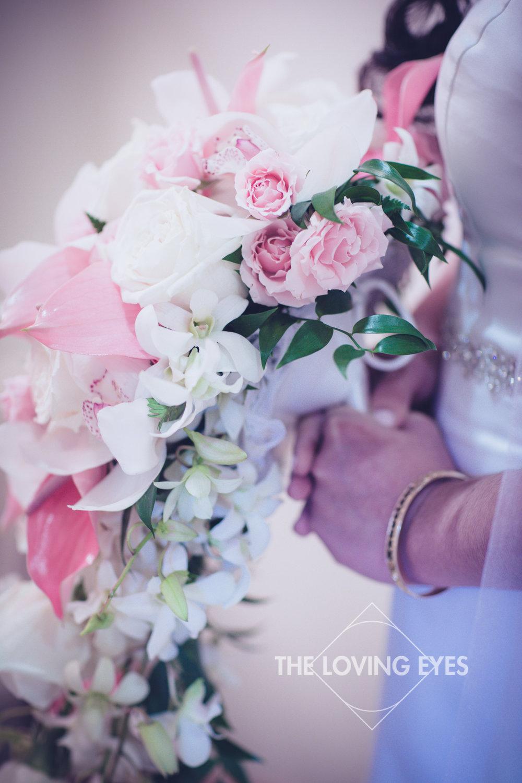 Bride getting ready in Bishop Memorial Chapel bridal suite