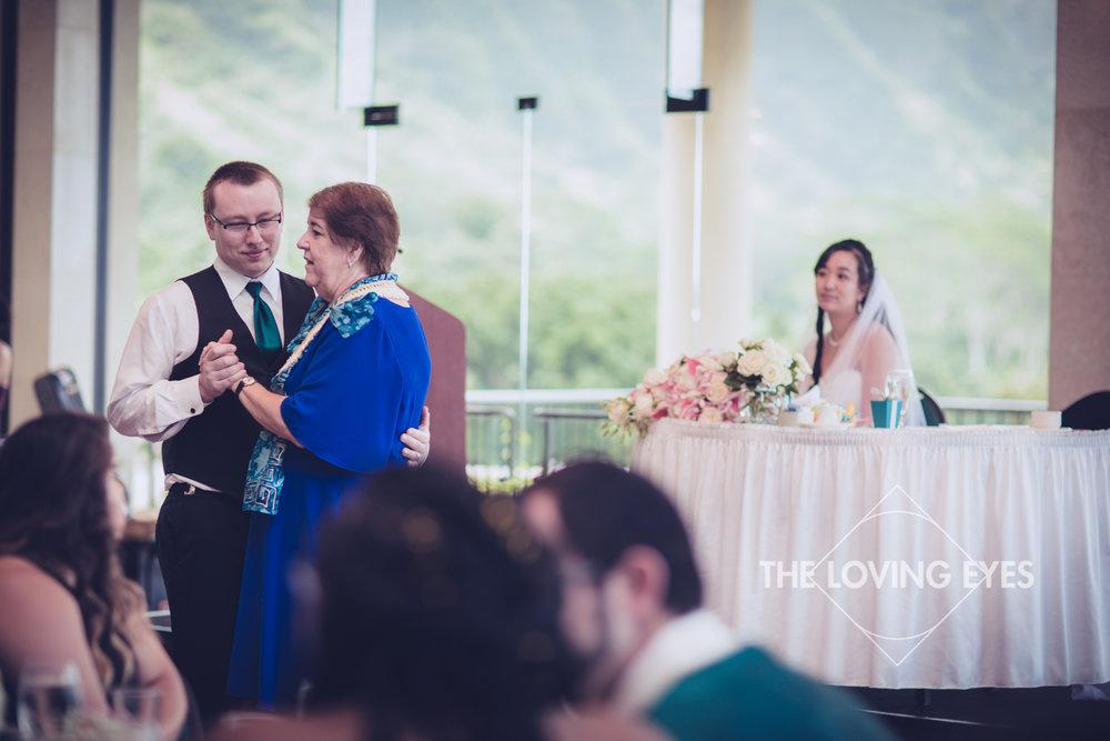 Mother and son dance during Wedding reception at Koolau Ballroom in Hawaii