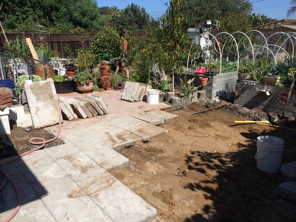 Concrete patio removal completed September 2014. Cost: $408