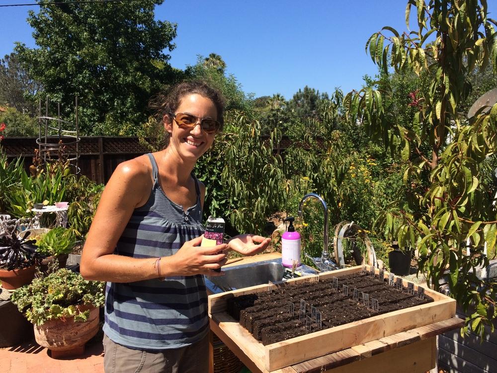 Barbara sowing seeds in soil blocks