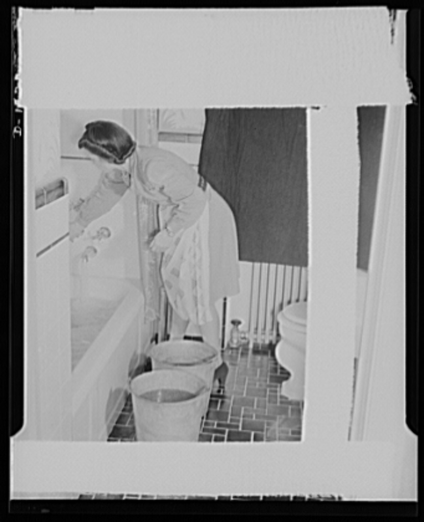 What the hell!? She is filling the bathtub and buckets as directed by the US government for use in case of fire or bomb raid. When the bomb sirens sound--fill your tub and such! 1941.Library of Congress, Prints and Photography Division, #LC-USE6- D-001822 and Photo Credit for bomb shelter: #LC-U9-6743-6