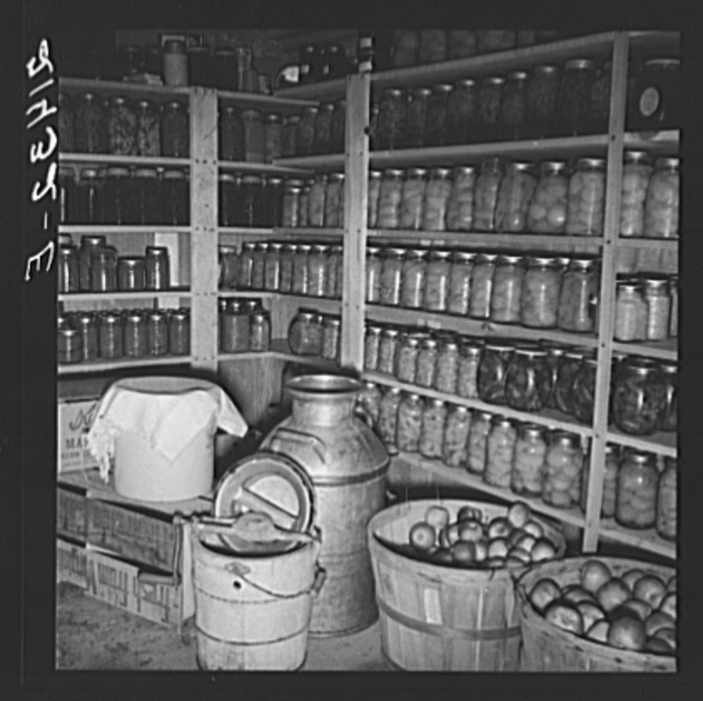 October 1939. Mrs. Botner's 800 quarts for winter. Note the crock with a cloth as well as the box for Kerr jars behind it. In 1937 the Farm Security Administration (FSA) was charged with working on the complex problem of farming and rural poverty. Self-sufficiency thus home food preservation were a part of the program. Library of Congress, Prints and Photography Division, FSA/OWI Collection, #LC-USF34- 021432-E.
