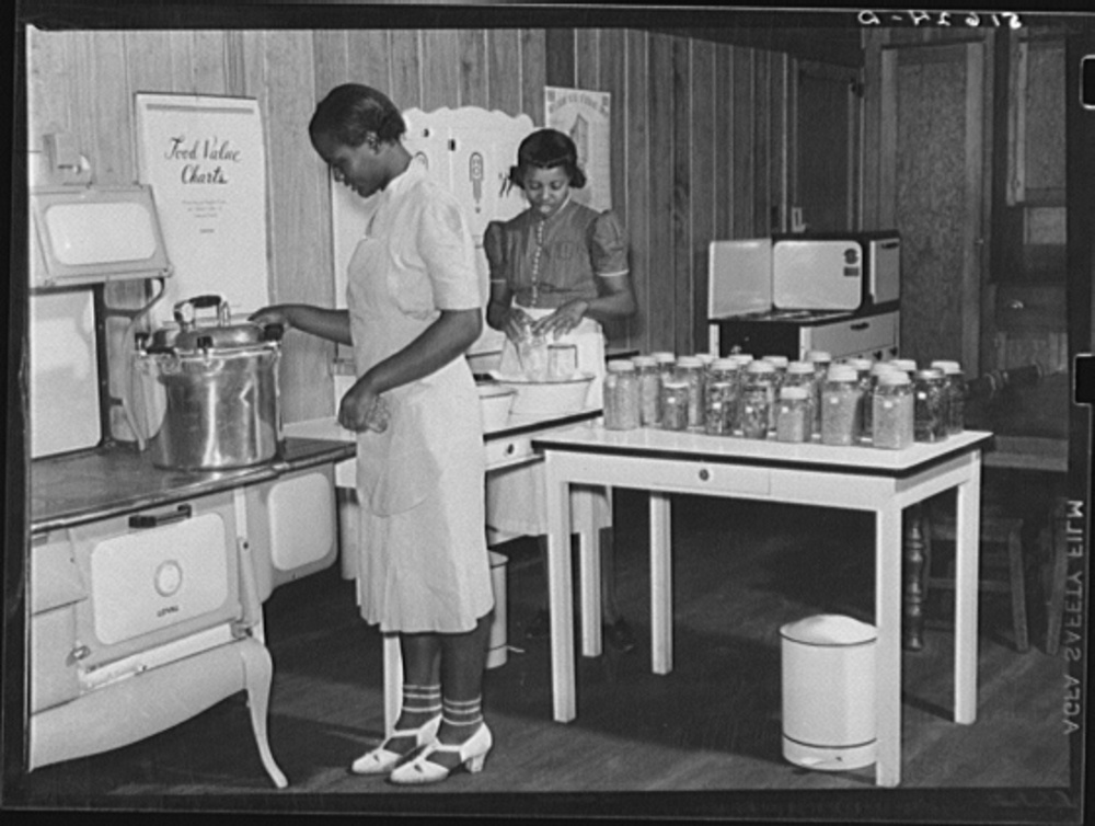 In 1937 the Farm Security Administration (FSA) was charged with working on the complex problem of farming and rural poverty. Self-sufficiency thus home food preservation were a part of the program. Lucille West and Nancy Engram at Flint River Farms, Georgia. May 1939. Library of Congress, Prints and Photography Division, FSA/OWI Collection, #LC-USF34- 051624-D.