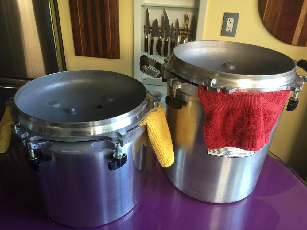 All American canners ready to be stored.    Kitchen towel(s) on the inside of the canner will absorb any moisture.  Inverting the lid protects the dial and vent pipe from damage. The towel prevents banging while allowing some air circulation so doesn't get moist inside the canner.