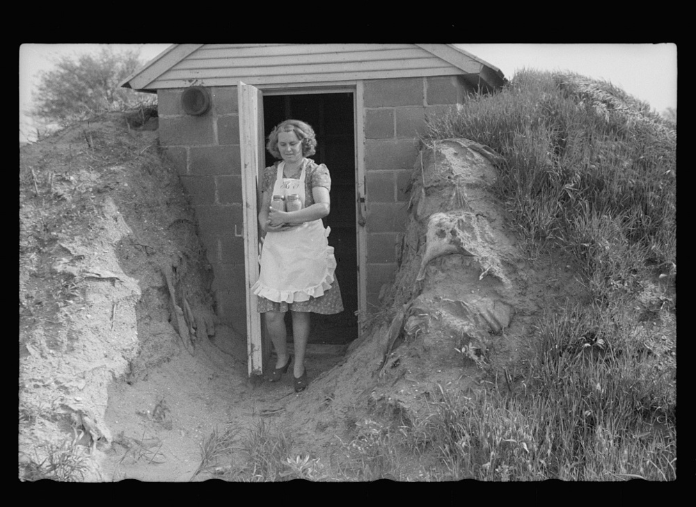 In 1937 the Farm Security Administration (FSA) was charged with working on the complex problem of farming and rural poverty. Self-sufficiency thus home food preservation were a part of the program. Food storage cave inspection. May 1940. Library of Congress, Prints and Photography Division, FSA/OWI Collection, #LC-USF33- 001873-M2.