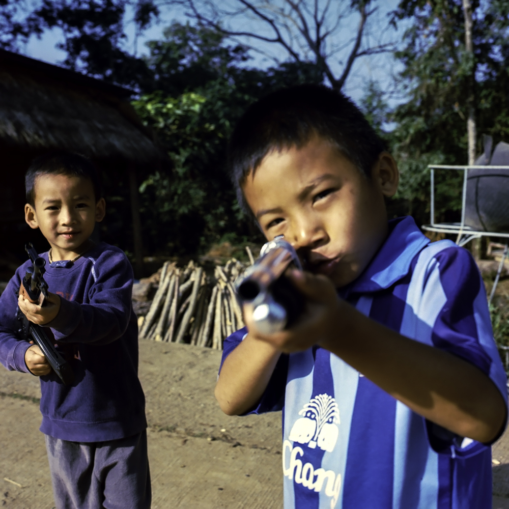 Boys with toy guns, Thailand. 2014