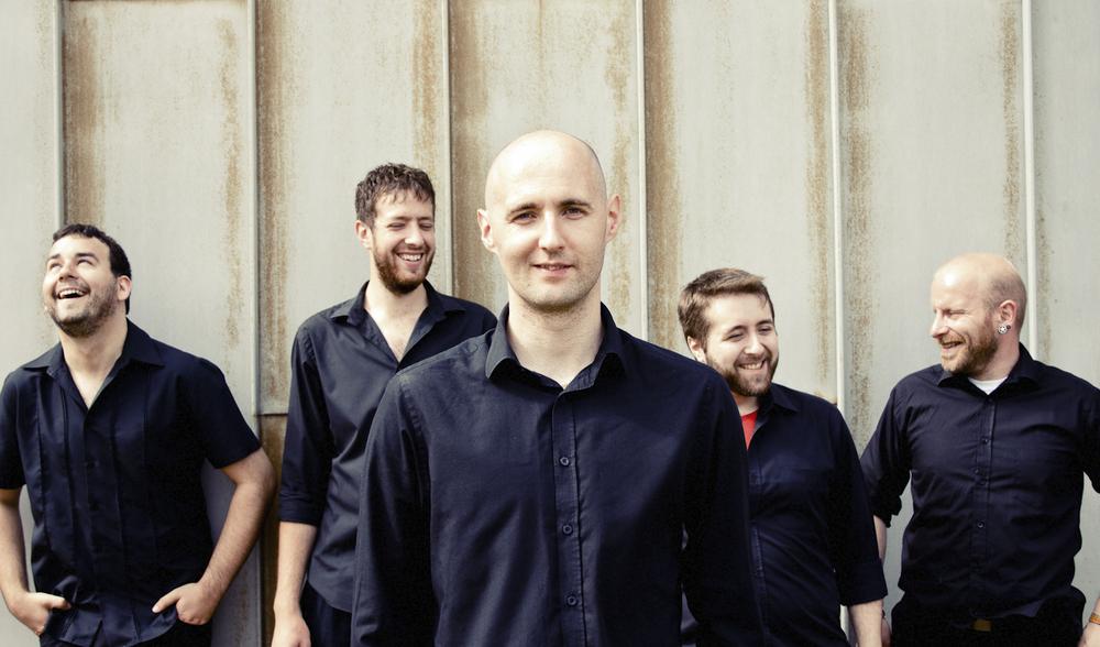 L-R: Tony Schonewald (lead guitar), Phil Wilkinson (rhythm guitar), Neil Martin (keys), Ross Ferguson (bass), Doug Farnan (drums)
