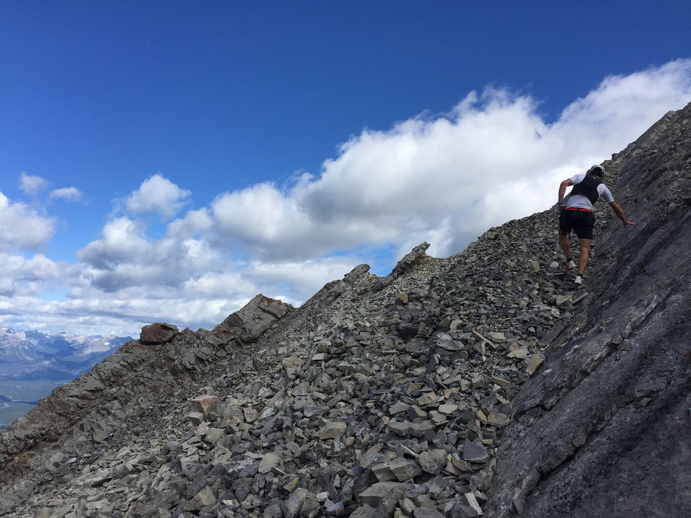 Adam scrambles to the ridge on Lady Mac