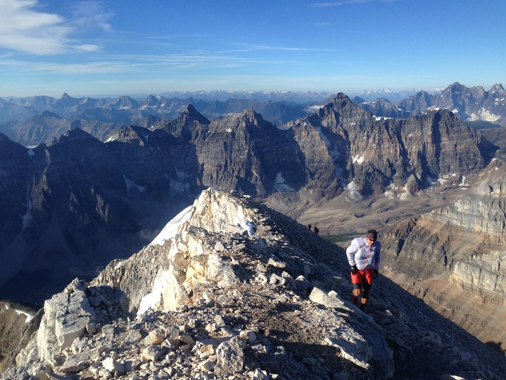 Final few feet to the summit - what a day! The Bugaboos are visible in the distance directly above my head.