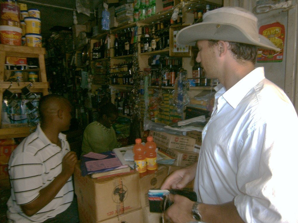 "Another corporation, a ""duka"" in Kisubi, Uganda (with yours truly engaging in a transaction)"