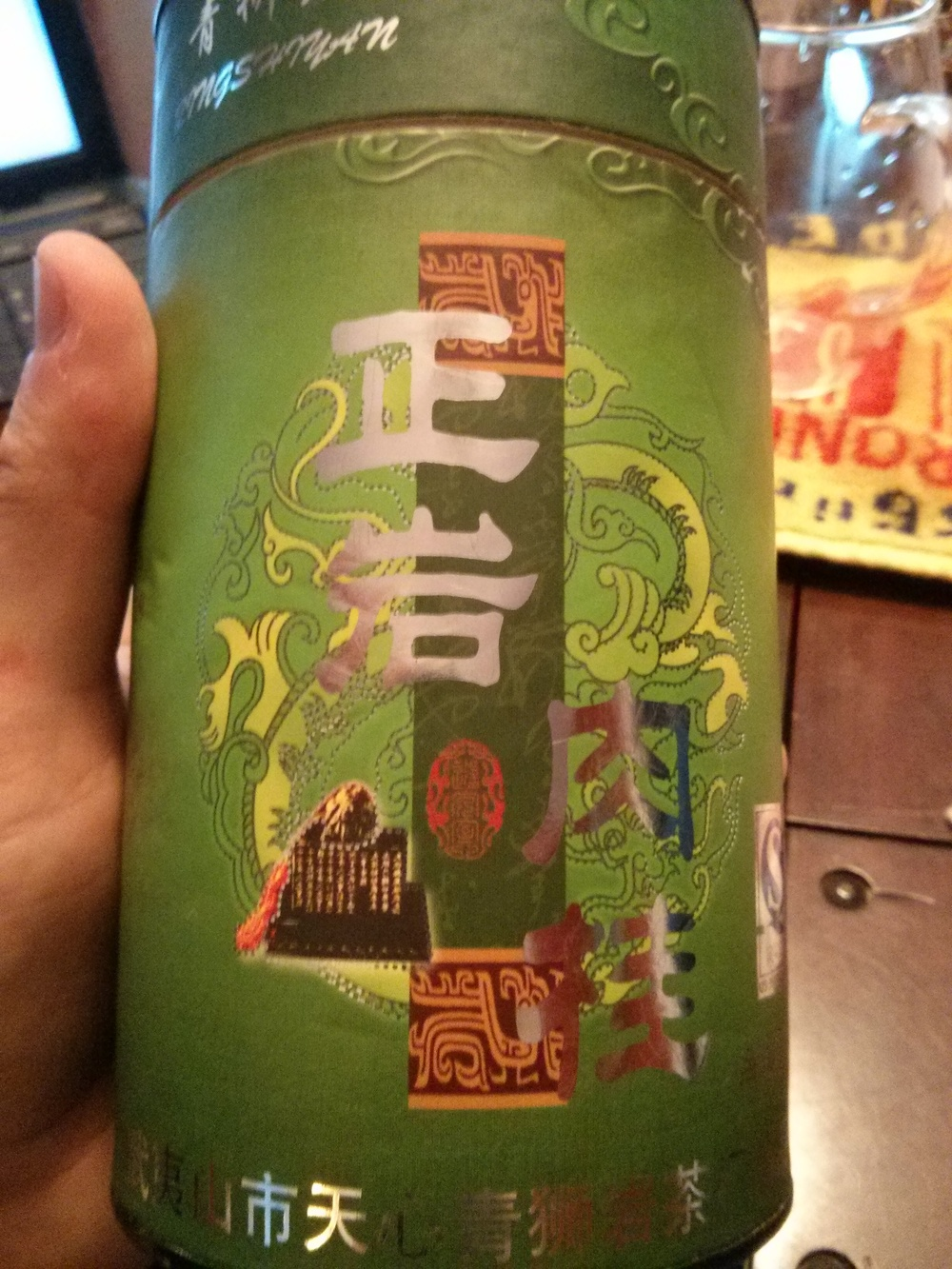 I had a nice variety of packaging, and this canister is really cool!  Tie Luo Han is a  Wuyi Rock Oolong  from the north of Fujian Province.  This tea is from  QingShi Rock Tea Factory .  My parents tasted tea there for two days and toured their factory.  This tea is a 2014 and its name means  Iron Monk Arhat  or  Iron Monk Warrior .  My parents even went to the tea farmer's house to take a picture with him and taste tea in their kitchen!