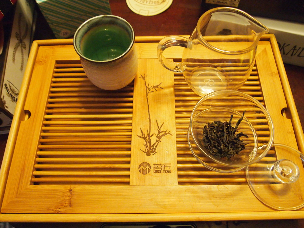 The basic teaware needed: a gaiwan (or small teapot), a pitcher (for cooling tea and sifting out smaller bits of tea), and a teacup (usually smaller than the one I have here). The tea used in this demonstration is Shui Xian ( Water Sprite)  a Wuyi Oolong.