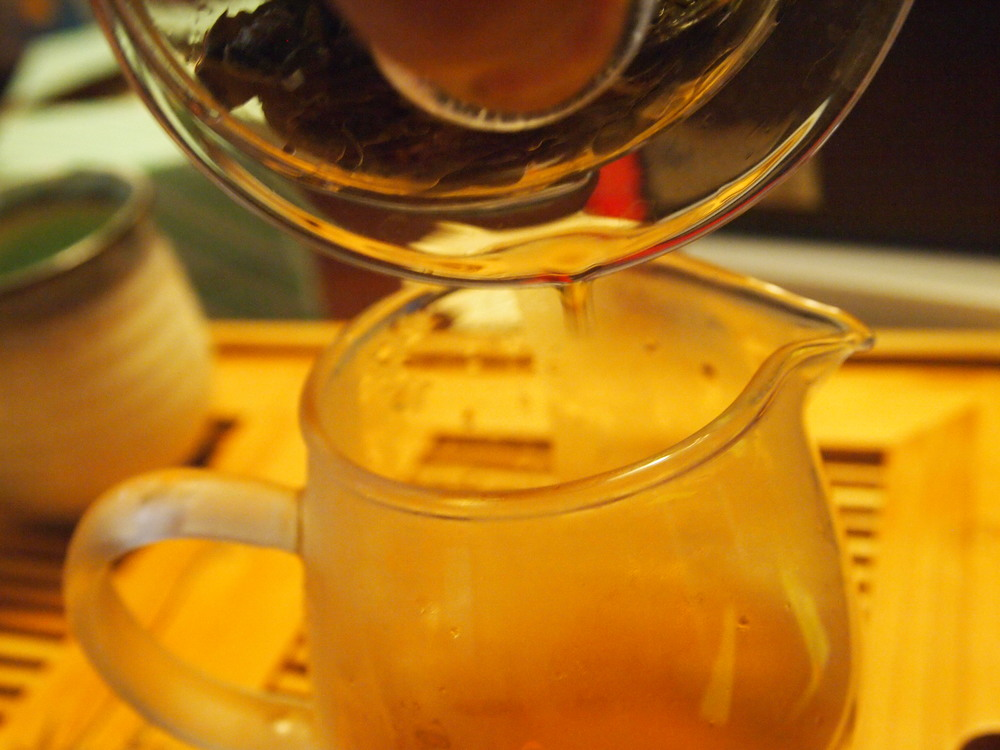 Pour the gaiwan or pot into a pitcher. Not pictured (I couldn't find it!) a strainer that fits into your pitcher in order to filter out tea particles. The transfer to a pitcher allows the tea to cool down faster to an enjoyable temperature.