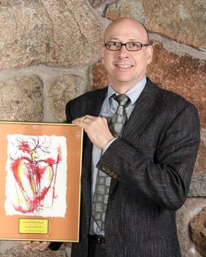 "Dr. Tips receives the 2010 ""Heart of Healing"" award."