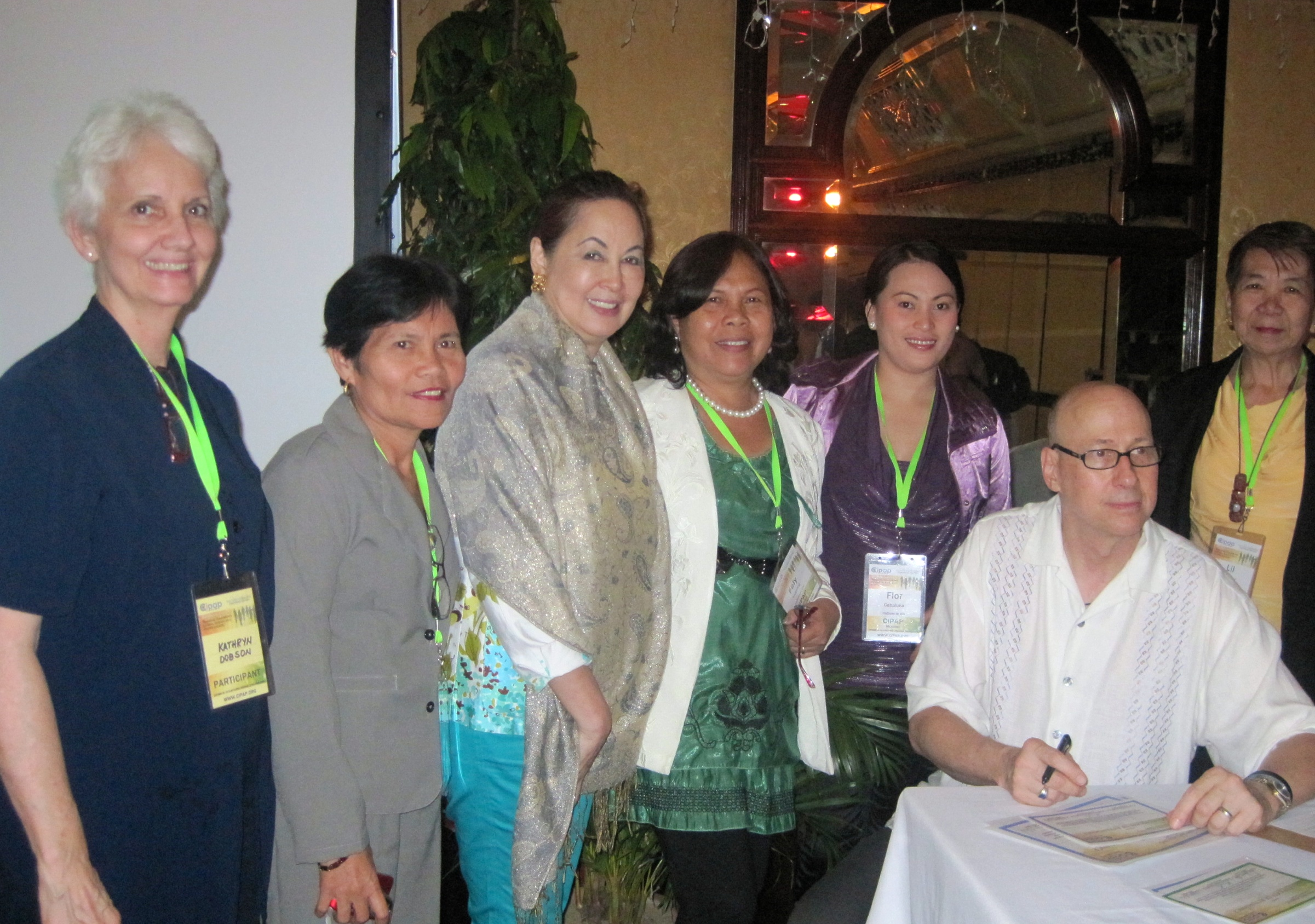 Jack Tips signs certifications for Filipina medical and natural health practitioners, Manila, 2010