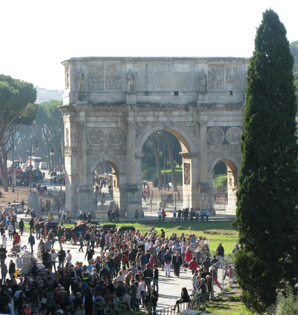 They flock by the thousands to the Colosseum past the Arch of Constantine