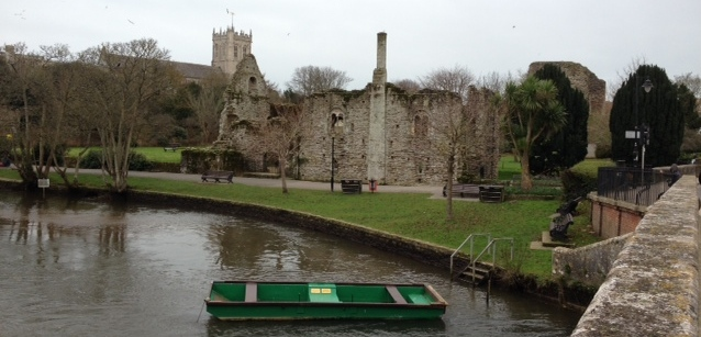 The ruins of the Great Tower of the Norman Castle with the Priory in the background - Christhchurch